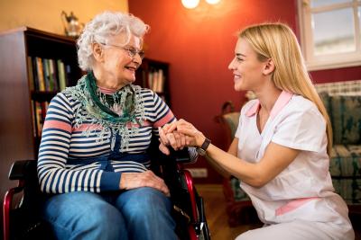 nurse console senior women in wheelchair at nursing home