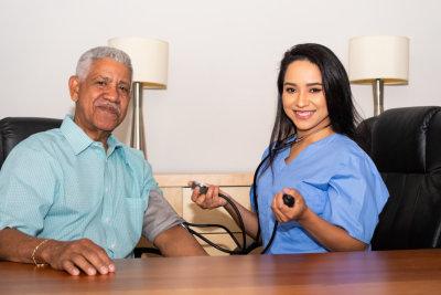 elder man and his nurse