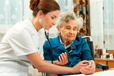 caregiver checking elderly woman
