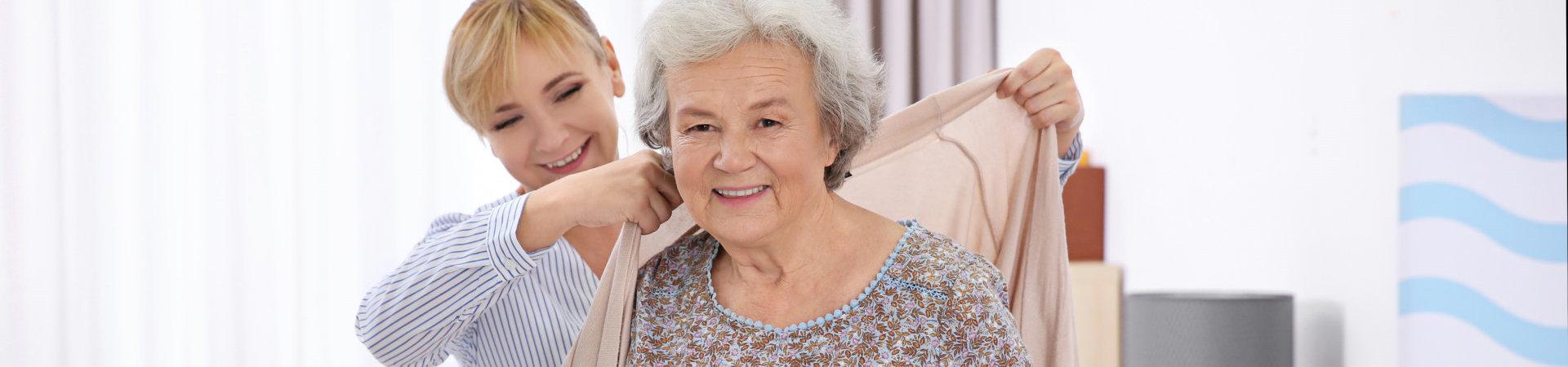 caregiver assisting senior woman
